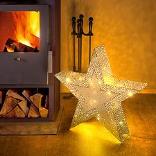 Kerstster - Honderden met de hand gefreesde gaatjes verspreiden een schitterend licht in Oosterse sfeer.