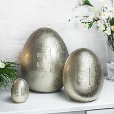 Metallic-ei - Bijzondere paasversiering: grote, goudkleurige, glanzende eieren in steen-look.