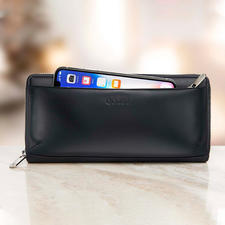 Het zacht beklede vak met rits aan de buitenkant is bedoeld voor uw mobiele telefoon.