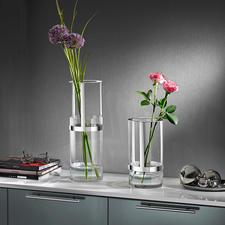 In hoogte verstelbare vaas - Deze met een prijs onderscheiden glazen vaas is perfect aan te passen aan elk boeket.
