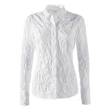 Batist-bloes met borduursels - Alstublieft nooit strijken. De klassieke witte blouse van fraaie batist, rondom bestikt.