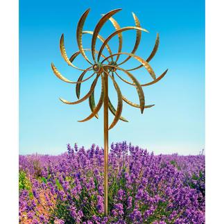 Duo-windmolen Twee in tegengestelde richting draaiende windmolens vormen een magische blikvanger.