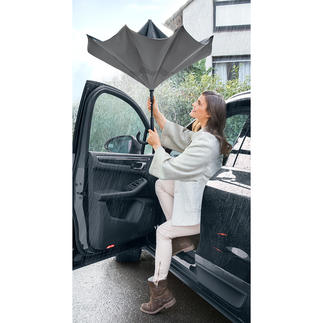 City-paraplu Ondanks hevige regenbuien: droog uit de auto, de bus en de trein stappen – zonder anderen te hinderen.