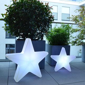 3D-lichtster De ster onder de kerstdecoraties.