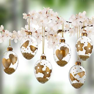 Glazen paaseieren met goudkleurige motieven, set van 6 Aan de buitenkant met de hand versierd met bloemetjes, vogels en hartjes. Gevuld met licht glanzend, goudkleurig granulaat.