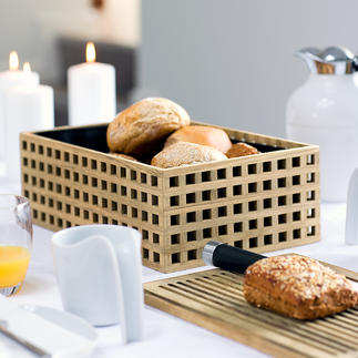 Broodtrommel van eikenhout Luchtdoorlatend, maar kruimeldicht, van chic eikenhout met roosterstructuur. Het houten deksel is tegelijkertijd serveer- en snijplank.