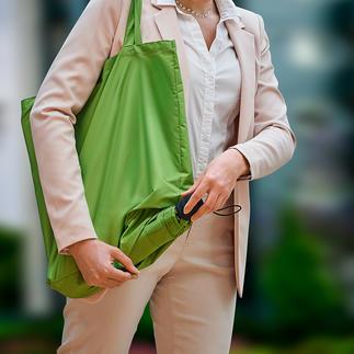 Duurzame opvouwbare paraplu Ingenieus: opvouwbare paraplu en boodschappentas in één. Duurzaam gemaakt van gerecyclede kunststoffen.