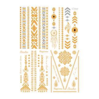 Tijdelijke tattoos Zomertrend: gouden sieradentatoeages op een licht gebruinde huid – gewoon opplakken.