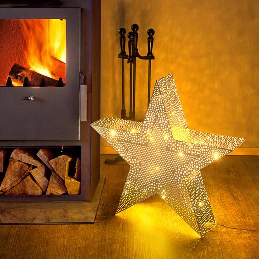kerstster honderden met de hand gefreesde gaatjes verspreiden een schitterend licht in oosterse sfeer