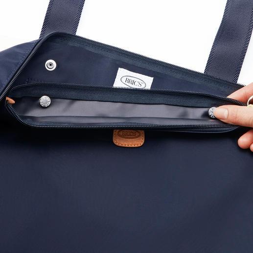 Het binnentasje is eenvoudig met 2 drukknopen in het hoofdvak van de grote tas vast te maken.