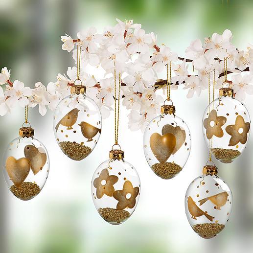 Glazen paaseieren met goudkleurige motieven, set van 6 - Aan de buitenkant met de hand versierd met bloemetjes, vogels en hartjes. Gevuld met licht glanzend, goudkleurig granulaat.