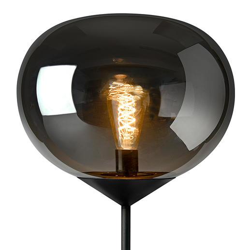 Wanneer u het licht aandoet, wordt de glazen kap als op magische wijze doorzichtig en is de brandende gloeilamp te zien.