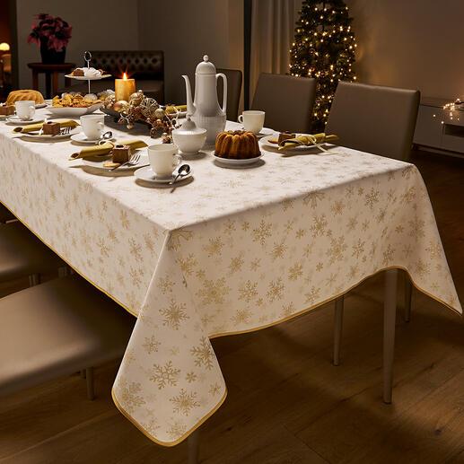 Kerst-tafellaken van damast Feestelijk, maar niet te uitbundig. Met luxueus ingeweven randdessin en fonkelende sneeuwvlokken.