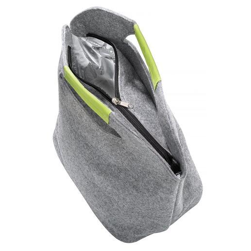 De tas wordt geopend met een rits en kan gemakkelijk van bovenaf worden gevuld.