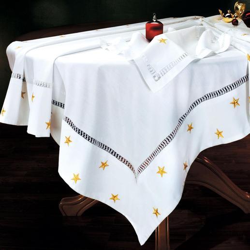 Kersttafellaken Bijzonder fijn tafellinnen.Elegante, soepel vallende kwaliteit,kunstig geborduurd met glinsterende sterretjes.