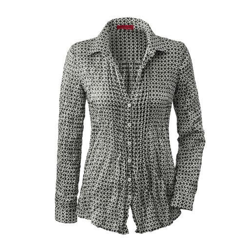 Nooit meer strijken: de blouse van fijne crashzijde. Dit ruimtebesparende lichtgewicht gaat moeiteloos mee in elke reiskoffer. Weegt slechts 86 gram.
